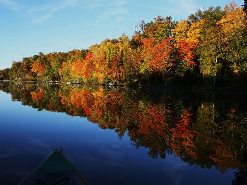 Kayaking on Vilas County Wisconsin lake in fall