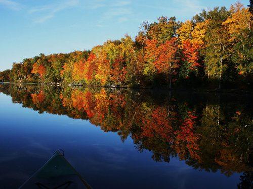 Kayaking on Vilas County Wisconsin lake in fall