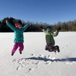 Children on a snow-covered lake Presque Isle Wisconsin